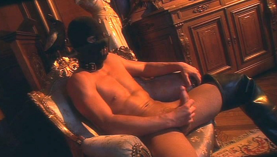 Tough guy with a mask watching porn and jerking off